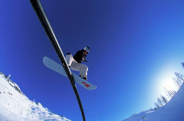 Alpen Glow Wall Art - Photograph - A Young Man Slides A Rail by Lucas Kane