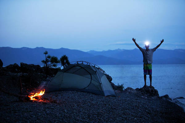 Wall Art - Photograph - A Young Man Smiling Next To A Campfire by Patrick Orton