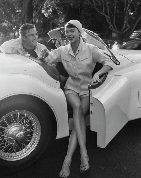 Photograph - A Young Model Sitting In A Convertible Sports Car by Karen Radkai