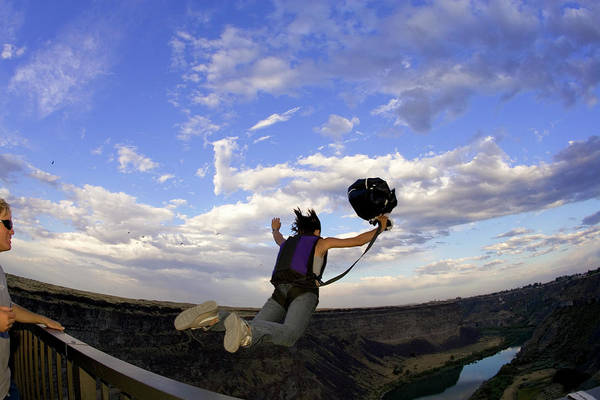 Base Jumping Photograph - A Young Woman Base Jumping Off Of A 480 by Corey Rich