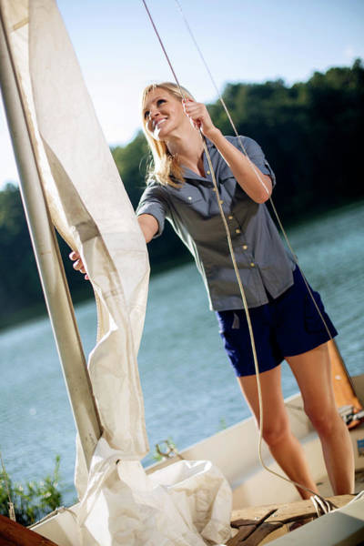 Wall Art - Photograph - A Young Woman Finishes Sailing by Corey Nolen