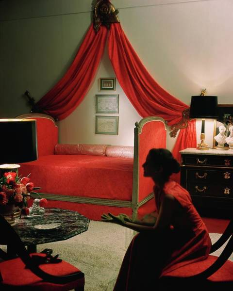 Illuminated Photograph - A Young Woman Sitting In A Red Bedroom by Horst P. Horst