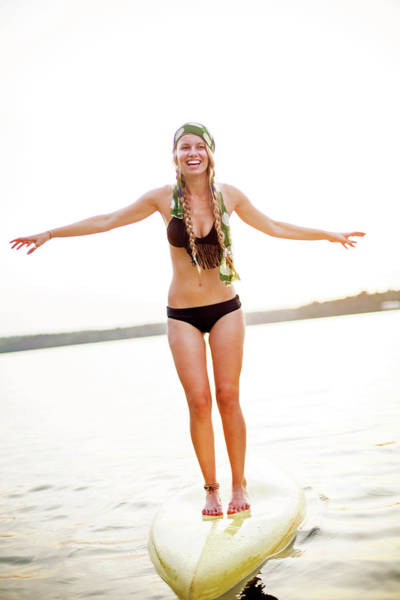 Wall Art - Photograph - A Young Woman Stands On A Paddle Board by Corey Nolen