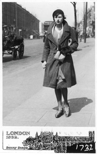 The Mitten Photograph - A Young Woman Walking Down A  Street by Mary Evans Picture Library