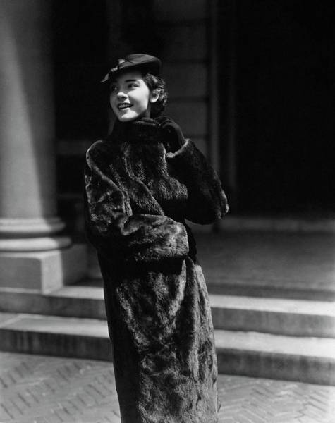 Beret Photograph - A Young Woman Wearing A Fur Coat by Lusha Nelson