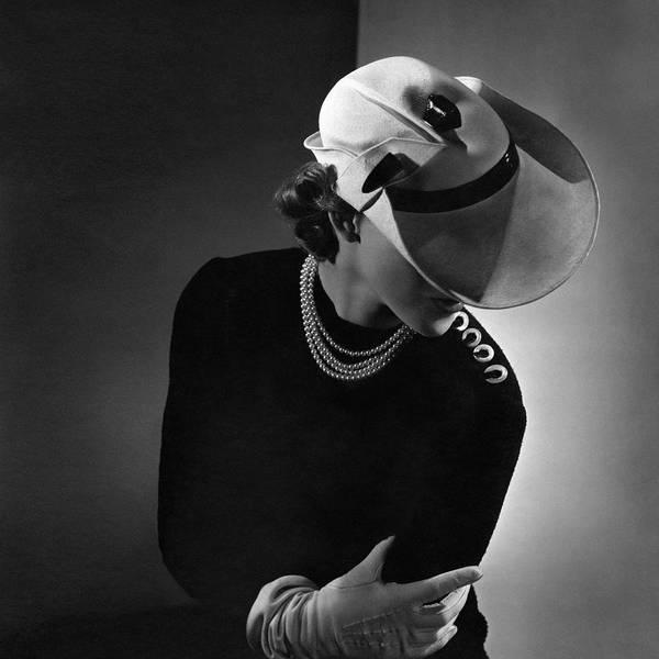 Wall Art - Photograph - A Young Woman Wearing A White Hat And A Pearl by Horst P. Horst