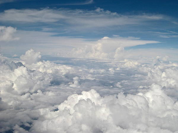 Photograph - Above The Clouds Over Texas Image A by Byron Varvarigos