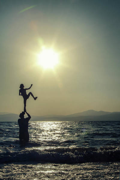 Silhouette Photograph - Acrobatic Balance Silhouette On Sea by Avi Morag Photography