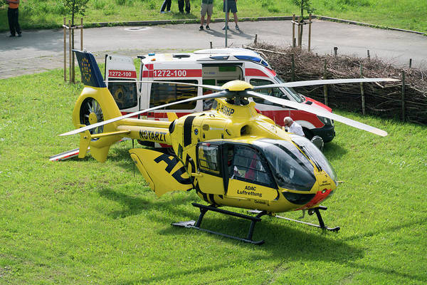 May Day Photograph - Adac Helicopter And Ambulance by Wladimir Bulgar/science Photo Library