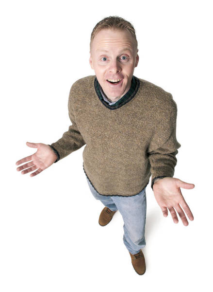Adult Caucasian Man Dressed In Jeans And Green Sweater Gestures With His Hands Shrugs His Shoulders Art Print by Photodisc