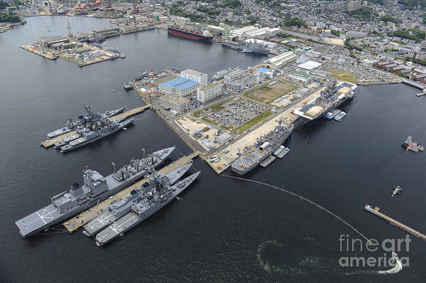 Uss Whidbey Island Photograph - Aerial View Of Military Ships Moored by Stocktrek Images
