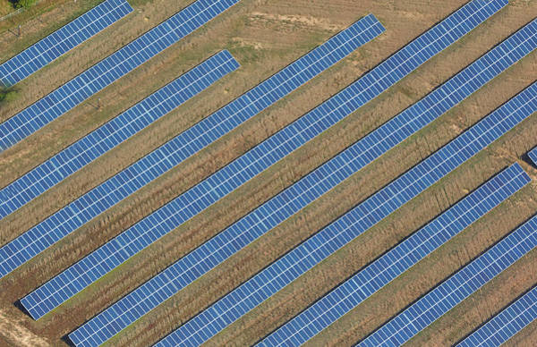 Environmental Issues Photograph - Aerial View Of Solar Panels In Field by Allan Baxter