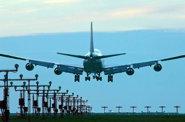 Wall Art - Photograph - Aeroplane Landing by David Nunuk/science Photo Library