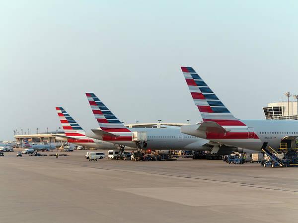 United Airlines Wall Art - Photograph - Aeroplanes At Airport Gates by Daniel Sambraus/science Photo Library