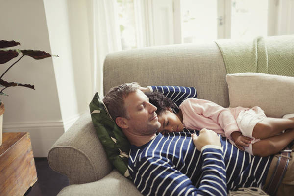 Affectionate, Serene Multi-ethnic Father And Daughter Napping On Sofa Art Print by Caiaimage/Paul Bradbury