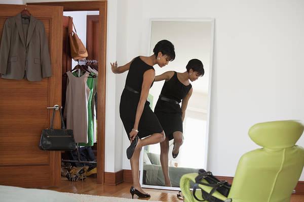 African American Woman Dressing In Bedroom Art Print by Ariel Skelley