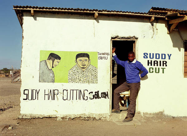 Real People Photograph - African Barber In Door Of His Shop by Harry Hook