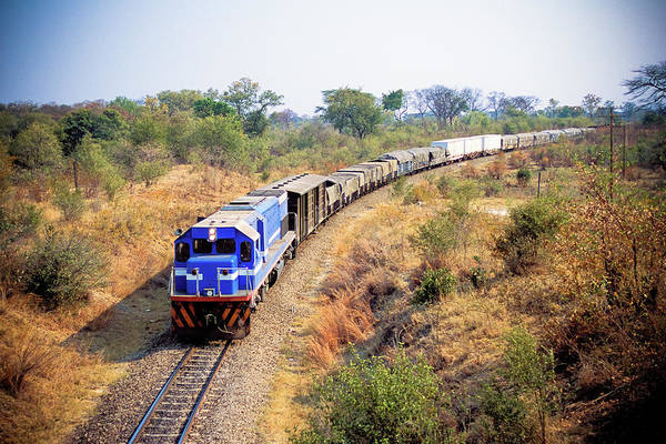 Freight Transport Wall Art - Photograph - African Cargo Train Between Zimbabwe by Beyondimages