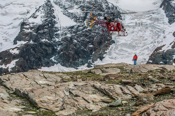 Wall Art - Photograph - Air Zermatt Rescue Helicopter Picking by Thomas Bekker