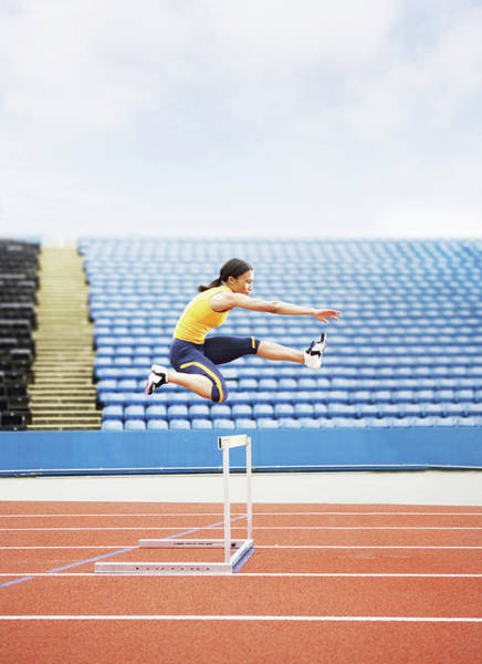 Exertion Wall Art - Photograph - Airborne Hurdler by Gustoimages/science Photo Library