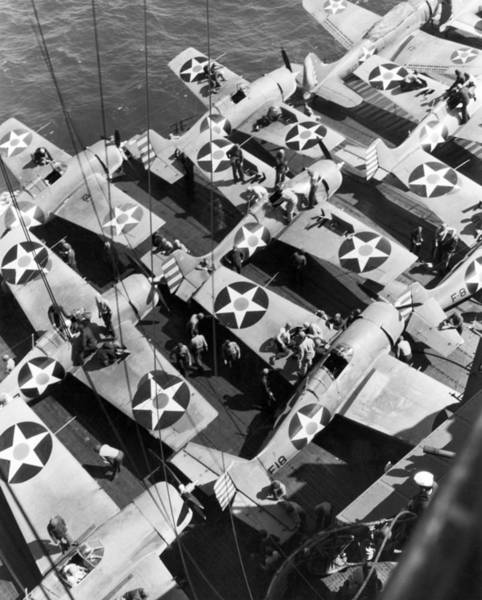 Photograph - Aircraft Carrier Planes Reload by Underwood Archives