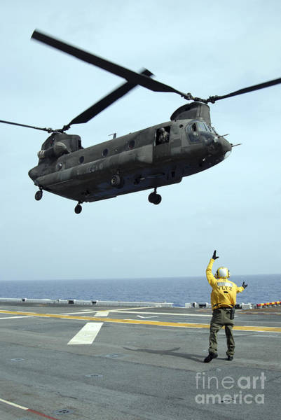 Flight Deck Photograph - Airman Directs An Army Ch-47 Chinook by Stocktrek Images