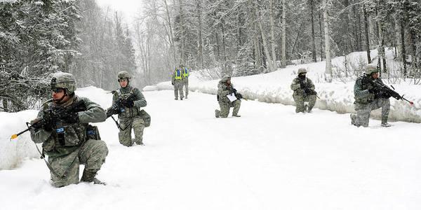 Elmendorf Photograph - Airmen Perform Tactical Maneuvers by Stocktrek Images