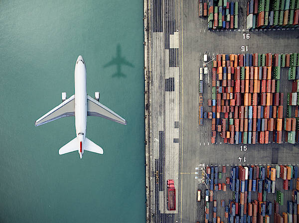 Airplane Flying Over Container Port Art Print by Orbon Alija