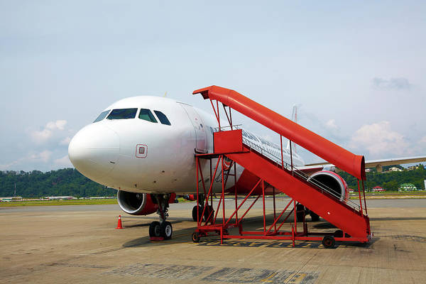 Taxiway Wall Art - Photograph - Airplane On The Airport Ready To Fly by Zhang Bo