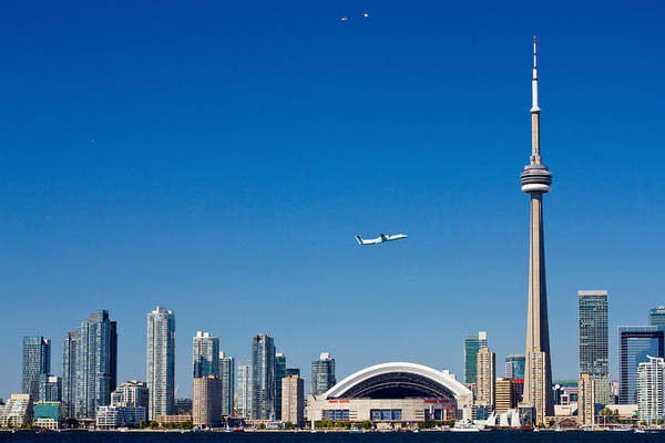Cn Tower Photograph - Airplane Over City Skylines, Cn Tower by Panoramic Images