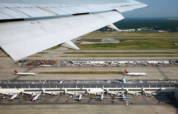 Taxiway Wall Art - Photograph - Airplane View Of An Airport by Jim West