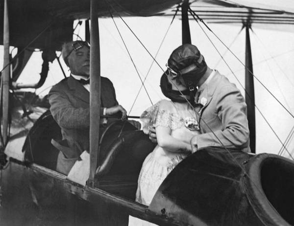 Photograph - Airplane Wedding Kiss by Underwood Archives