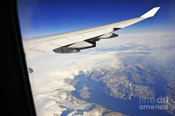 Wall Art - Photograph - Airplane Wing Over Snowy And Rocky Coastline by Sami Sarkis