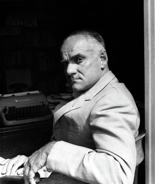 Italy Photograph - Alberto Moravia Sitting At His Desk by Horst P. Horst
