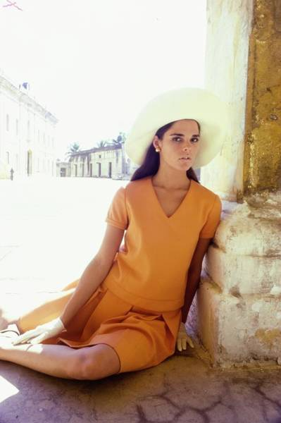 Busch Photograph - Ali Macgraw Wearing An Orange Suit by Sante Forlano