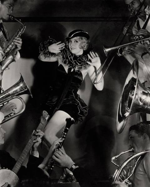 Wind Photograph - Alice White In Costume Surrounded By Men Playing by Florence Vandamm