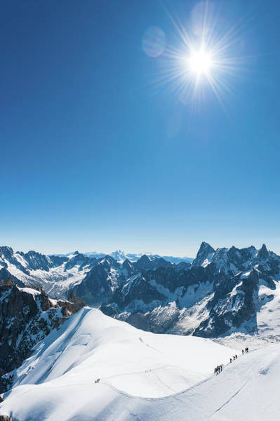 Chamonix Wall Art - Photograph - Alps Snow Summit Sunburst Mountaineers by Fotovoyager