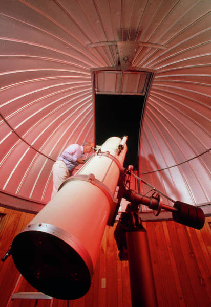 Astronomer Photograph - Amateur Astronomer Uses A Reflector Telescope by Ed Young/science Photo Library