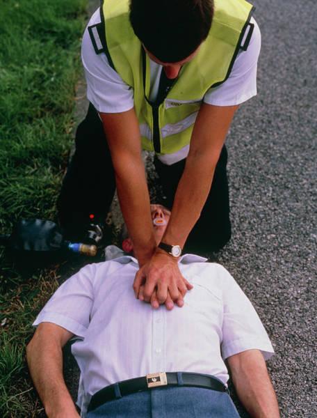 Heart Attack Wall Art - Photograph - Ambulanceman Giving Cardiac Massage To Man by Adam Hart-davis/science Photo Library