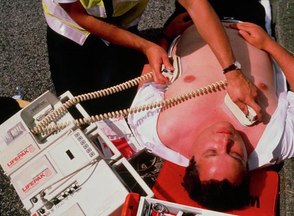 Heart Attack Wall Art - Photograph - Ambulanceman Treating Heart Attack Patient by Adam Hart-davis/science Photo Library