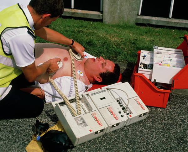 Heart Attack Wall Art - Photograph - Ambulanceman Using Portable Defibrillator by Adam Hart-davis/science Photo Library