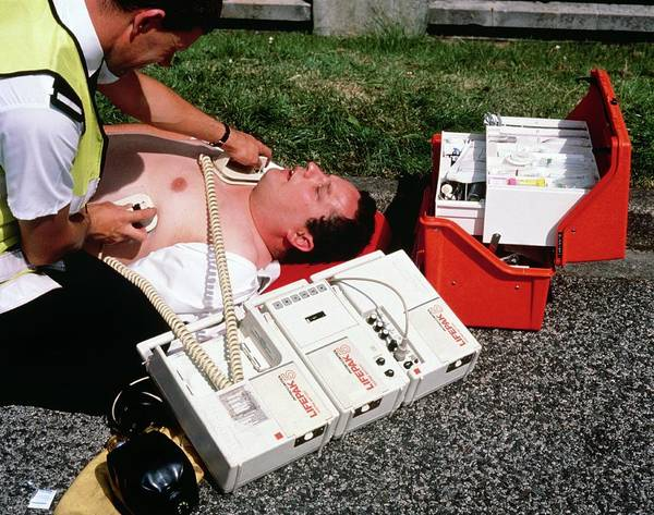 Heart Attack Wall Art - Photograph - Ambulanceman Using Portable Defibrillator Machine by Adam Hart-davis/science Photo Library
