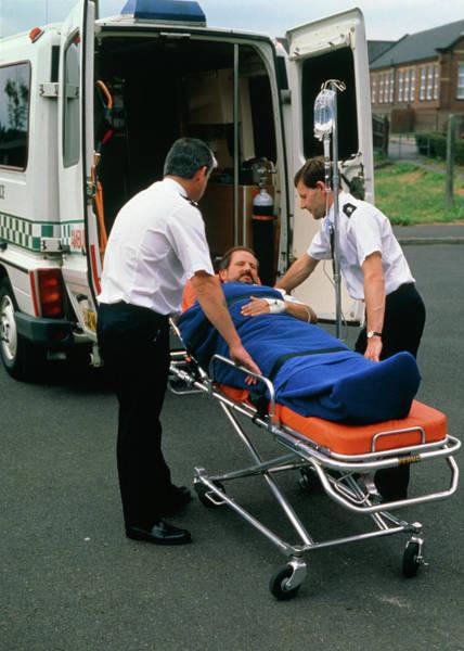 Patient Photograph - Ambulancemen Loading Patient Into Ambulance by Adam Hart-davis/science Photo Library