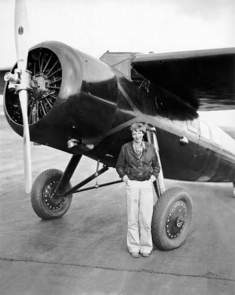 Appearance Photograph - Amelia Earhart And Her Plane by Underwood Archives