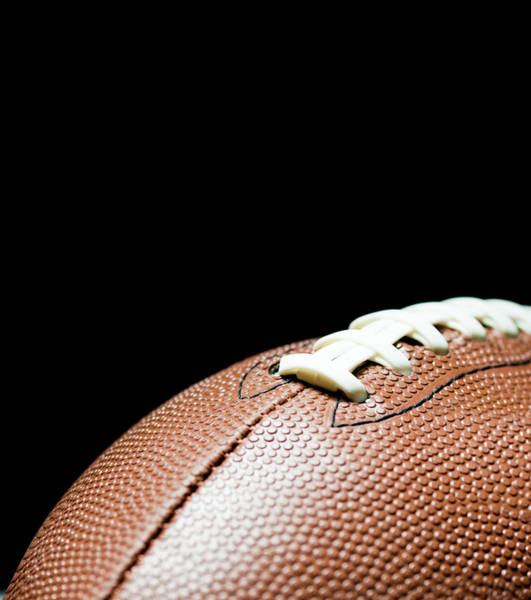 American Football Photograph - American Football On Black Background by By nicholas