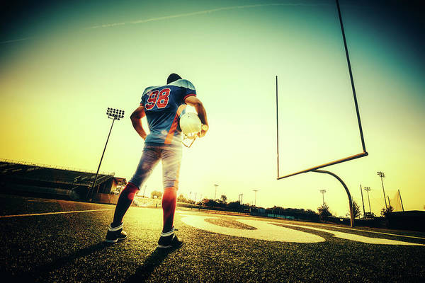 Football Helmet Photograph - American Football Player by Ferrantraite