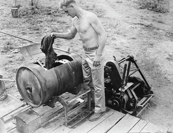 Dirty Laundry Photograph - American Soldier Doing His Weekly by Stocktrek Images