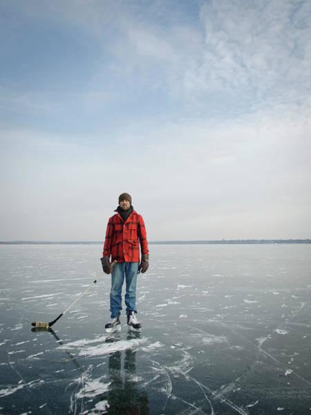 Lake Monona Photograph - An Adult Male Playing Ice Hockey Poses by David Nevala