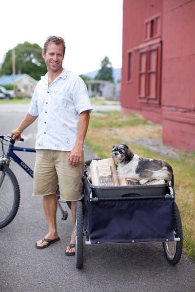 Service Dog Photograph - An Adult Man With His Bike, Trailer by Woods Wheatcroft