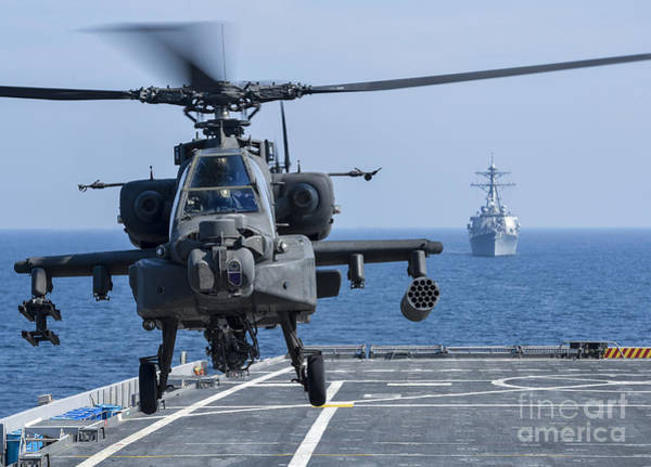 Airborne Photograph - An Army Ah-64d Apache Helicopter Takes by Stocktrek Images